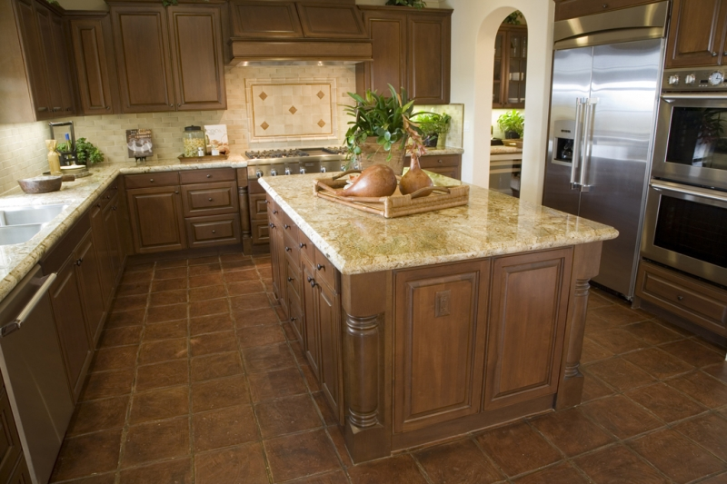 Modern Kitchen with brown tiles.