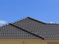 black tiles roof on a new house